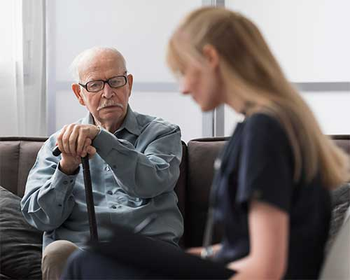old man with young nurse in long term care